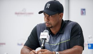 Tournament Host Tiger Woods answers questions from the media during a press conference Tuesday at the Quicken Loans National golf tournament being played at Congressional Country Club in Bethesda, Maryland. Photo: Pete Marovich Special to The Washington Times **FILE**