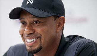 Tournament Host Tiger Woods answers questions from the media during a press conference Tuesday at the Quicken Loans National golf tournament being played at Congressional Country Club in Bethesda, Maryland. (Pete Marovich Special to The Washington Times)