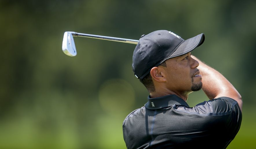Tiger Woods on the practice tee Tuesday at the Quicken Loans National golf tournament at Congressional Country Club in Bethesda, Maryland. Photo: Pete Marovich Special to The Washington Times