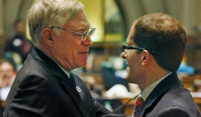 Democratic House Speaker Rep. Mark Ferrandino, right, hugs his Republican colleague Rep. Bob Gardner, following a tribute to Gardner's service in the state house, on the last day of the Spring session at the Colorado Legislature, in Denver, Wednesday, May 7, 2014. Both men are outgoing representatives. Banking for marijuana businesses and property tax forgiveness for disaster victims headlined the final day of the ColoradoLegislature on Wednesday, though the last hours were lacking the drama of many past sessions.  (AP Photo/Brennan Linsley)