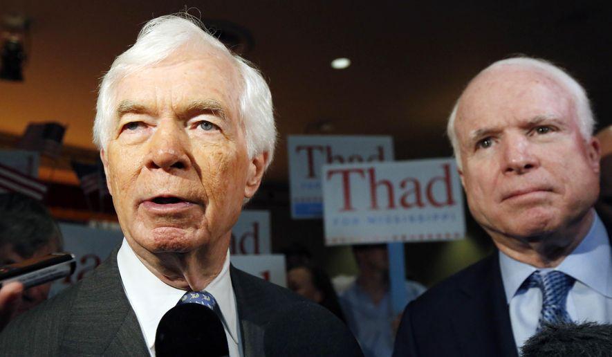 Sen. Thad Cochran of Mississippi and Sen. John McCain of Arizona at a rally. (AP Photo/Rogelio V. Solis)