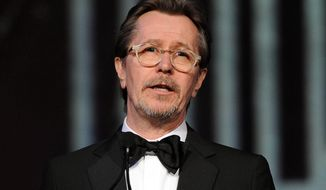 ** FILE ** This Jan. 4, 2014, file photo shows actor Gary Oldman speaking at the Palm Springs International Film Festival Awards Gala at the Palm Springs Convention Center in Palm Springs, Calif. (Photo by Frank Micelotta/Invision/AP, File)