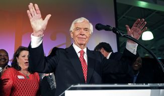 U.S. Sen. Thad Cochran, R-Miss., waves to supporters and volunteers at his runoff election victory party Tuesday, June 24, 2014, at the Mississippi Children's Museum in Jackson, Miss. Cochran defeated state Sen. Chris McDaniel of Ellisville, in a primary runoff for the GOP nomination for senate. (AP Photo/Rogelio V. Solis)