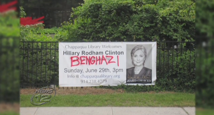 """New York police are searching for the suspects responsible for spray-painting """"BENGHAZI"""" in red across a sign outside the Chappaqua Public Library promoting an upcoming book signing by former Secretary of State Hillary Clinton. (News 12 Westchester)"""
