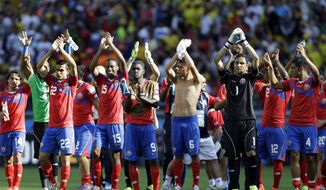 Costa Rica players greet supporters after the group D World Cup soccer match between Costa Rica and England at the Mineirao Stadium in Belo Horizonte, Brazil, Tuesday, June 24, 2014. Costa Rica has finished first in what many considered the World Cup's toughest group after a 0-0 draw against a second-string England side. (AP Photo/Fernando Vergara)