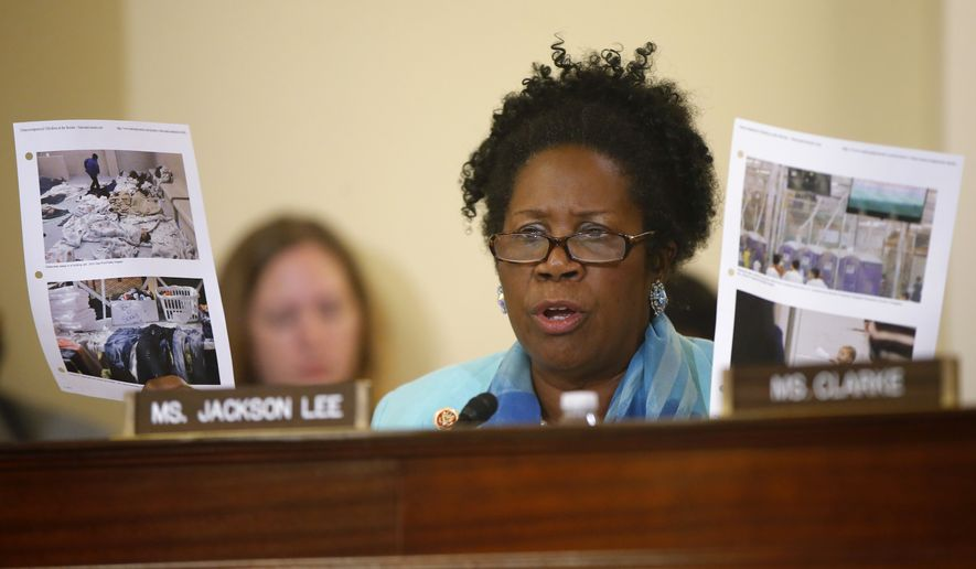 ** FILE ** House Homeland Security Committee member Rep. Sheila Jackson Lee, D-Texas, holds up photographs as she questions Homeland Security Secretary Jeh Johnson on Capitol Hill in Washington, Tuesday, June 24, 2014, during the committee's hearing regarding the growing problem of unaccompanied children crossing the border into the US. (AP Photo/Charles Dharapak)