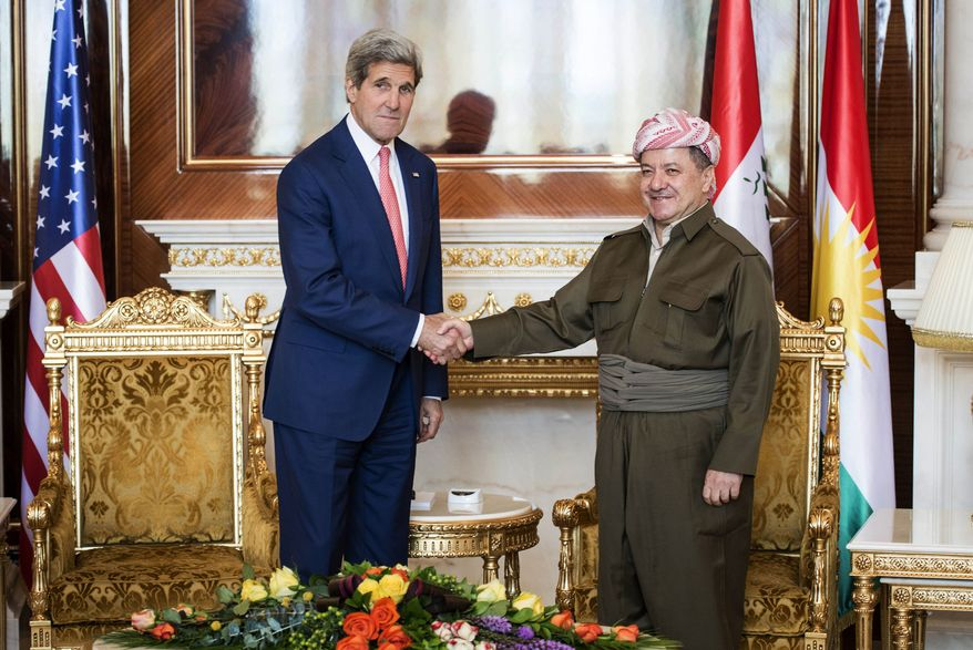 "Kurdish President Massoud Barzani, right, shakes hands for photographers with U.S. Secretary of State John Kerry at the presidential palace in Irbil on Tuesday, June 24, 2014. The president of Iraq's ethnic Kurdish region declared Tuesday that ""we are facing a new reality and a new Iraq"" as the country's Shiite-led government considers new leadership as an immediate step to curb a Sunni insurgent rampage. The comments by Barzani came as he met with Kerry, who is pushing the central government in Baghdad to at least adopt new policies that would give more authorities to Iraq's minority Sunnis and Kurds.(AP Photo/ Brendan Smialowski, Pool)"