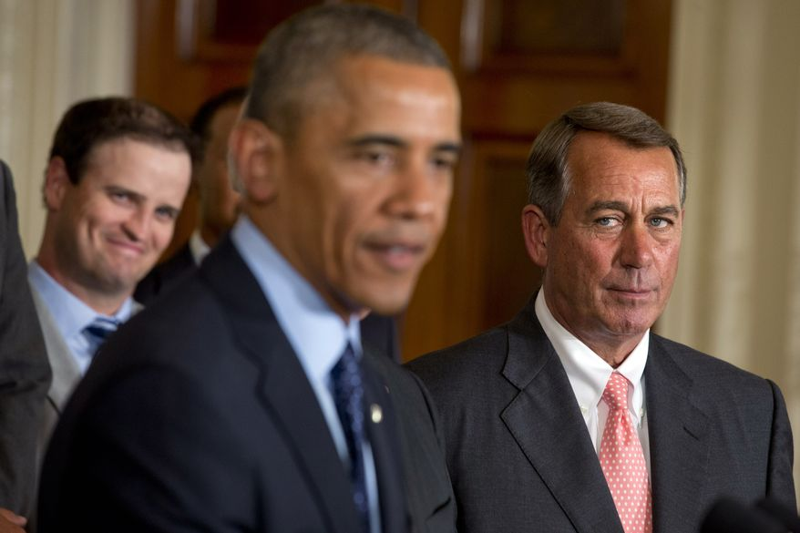 House Speaker John Boehner, R-Ohio, right, watches President Barack Obama speak, as golfer Zach Johnson watches at left, during a ceremony honoring the 2013 Presidents Cup U.S. team during a ceremony in the East Room of the White House, Tuesday, June 24, 2014 in Washington. The U.S. team beat an international squad during the Presidents Cup matches in October 2013. (AP Photo/Jacquelyn Martin)