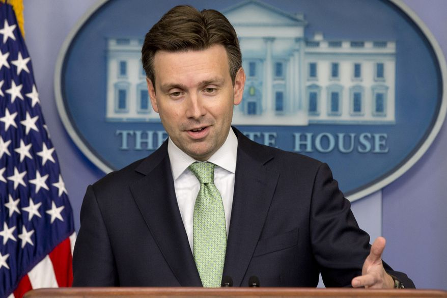 """White House Press secretary Josh Earnest speaks to the media during the daily briefing in the Brady Press Briefing Room of the White House, Tuesday, June 24, 2014 in Washington. The White House says it is """"reserving judgment"""" on Russian President Vladimir Putin's call for extending a weeklong cease-fire in Ukraine, saying it puts more stock in Russia's actions than its words. (AP Photo/Jacquelyn Martin)"""