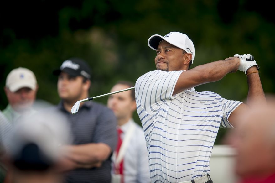 Tiger Woods tees off on the 10th hole during the pro-am at the Quicken Loans National golf tournament being played on Wednesday at Congressional Country Club in Bethesda, Maryland. PHOTO: Pete Marovich Special to The Washington Times
