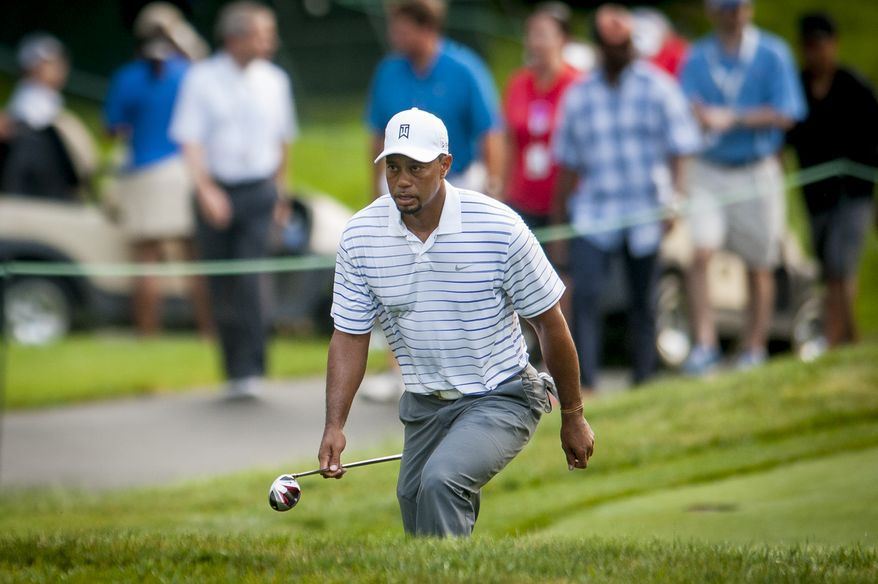Tiger Woods makes his way to the tee on the 12th hole during the pro-am at the Quicken Loans National golf tournament being played on Wednesday at Congressional Country Club in Bethesda, Maryland. PHOTO: Pete Marovich Special to The Washington Times