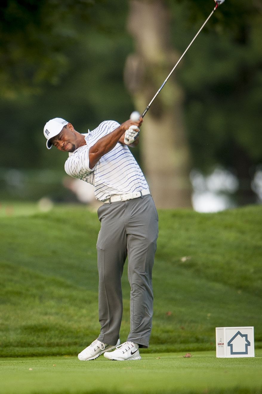 Tiger Woods tees off on the 12th hole during the pro-am at the Quicken Loans National golf tournament being played on Wednesday at Congressional Country Club in Bethesda, Maryland. PHOTO: Pete Marovich Special to The Washington Times