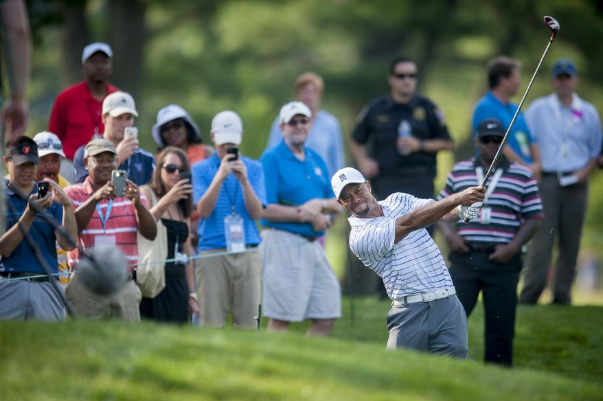 Tiger Woods hits out of the rough on the 17th hole during the pro-am at the Quicken Loans National golf tournament being played on Wednesday at Congressional Country Club in Bethesda, Maryland. PHOTO: Pete Marovich Special to The Washington Times