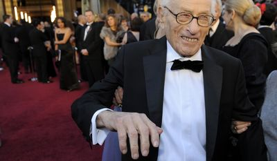 Eli Wallach arrives before the 83rd Academy Awards in Los Angeles on Feb. 27, 2011. (Associated Press)