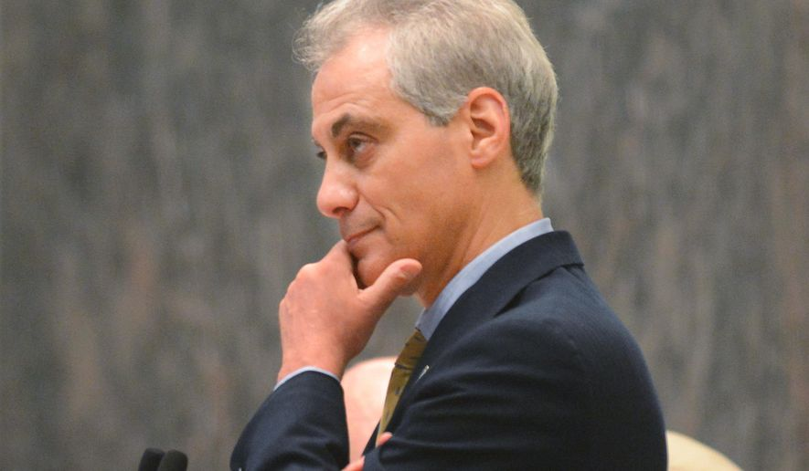 Chicago Mayor Rahm Emanuel listens during a Chicago City Council meeting Wednesday, June 25, 2014, in Chicago. During the meeting, the council approved an ordinance that dramatically limits where gun stores can operate and requires them to videotape every purchase to prevent one person from buying a gun for another. Aldermen voted 48-0 on Wednesday for the law that would prohibit gun shops in most of Chicago. (AP Photo/Sun-Times Media, Brian Jackson)  MANDATORY CREDIT, MAGS OUT, NO SALES