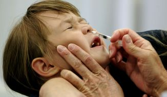 FILE - In this Oct. 4, 2005 file photo, Danielle Holland reacts as she is given a new FluMist influenza vaccination in St. Leonard, Md. A Federal advisory panel agreed on Wednesday, June 25, 2014, to tell doctors that FluMist nasal spray is a bit better at preventing flu in healthy young kids. (AP Photo/Chris Gardner, File)