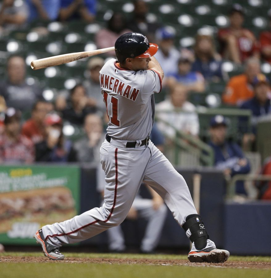Washington Nationals' Ryan Zimmermann follows through a two-run home run against the Milwaukee Brewers during the 16th inning of a baseball game Wednesday, June 25, 2014, in Milwaukee. (AP Photo/Jeffrey Phelps)