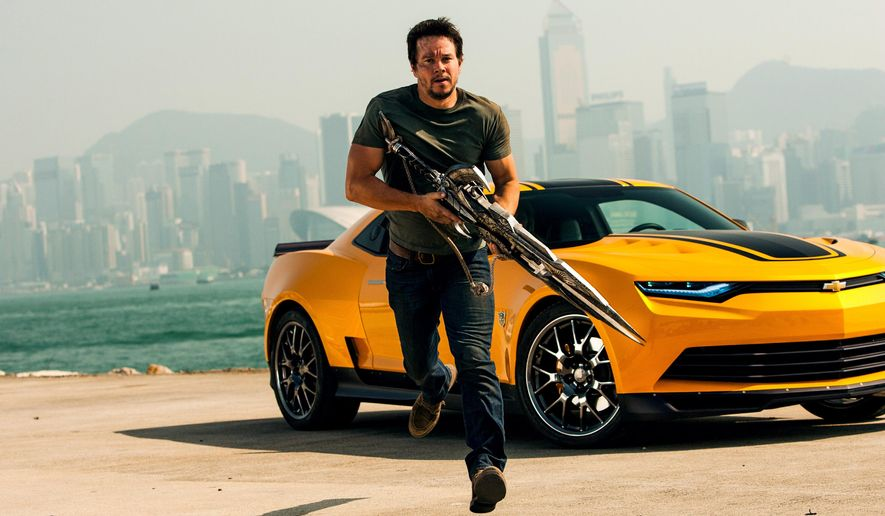 "This photo released by Paramount Pictures shows Mark Wahlberg as Cade Yeager, in the film, ""Transformers: Age of Extinction."" (AP Photo/Paramount Pictures, Andrew Cooper)"