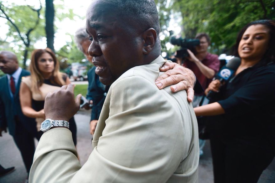 Charlie Bothuell IV becomes emotional after arriving home after the Detroit Police Department found his missing 12-year-old son, Charlie Bothuell V, in the basement of his home in Detroit, on Wednesday, June 25, 2014. The younger Bothuell had been missing for a week and a half. (AP Photo/Detroit Free Press, Kimberly P. Mitchell)