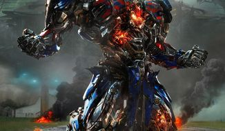 "Optimus Prime returns to the big screen with his fellow shape-shifting robots in the film, ""Transformers: Age of Extinction."" (Paramount Pictures viA Associated Press)"