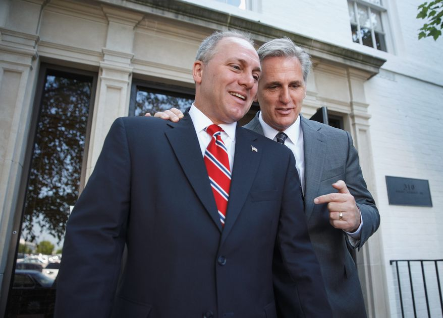 Incoming House Majority Whip Rep. Steve Scalise, Louisiana Republican (left), talks with Majority Leader-elect Rep. Kevin McCarthy, California Republican. Mr. Scalise was seen as the choice of conservatives eager to install a voice of their own in the upper ranks of leadership. (Associated Press)