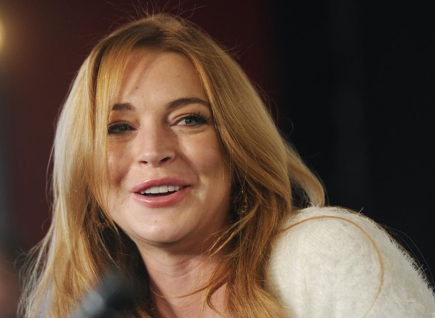 Actress Lindsay Lohan addresses reporters during a news conference at the 2014 Sundance Film Festival in Park City, Utah, in this Jan. 20, 2014, file photo. (Photo by Chris Pizzello/Invision/AP, File)