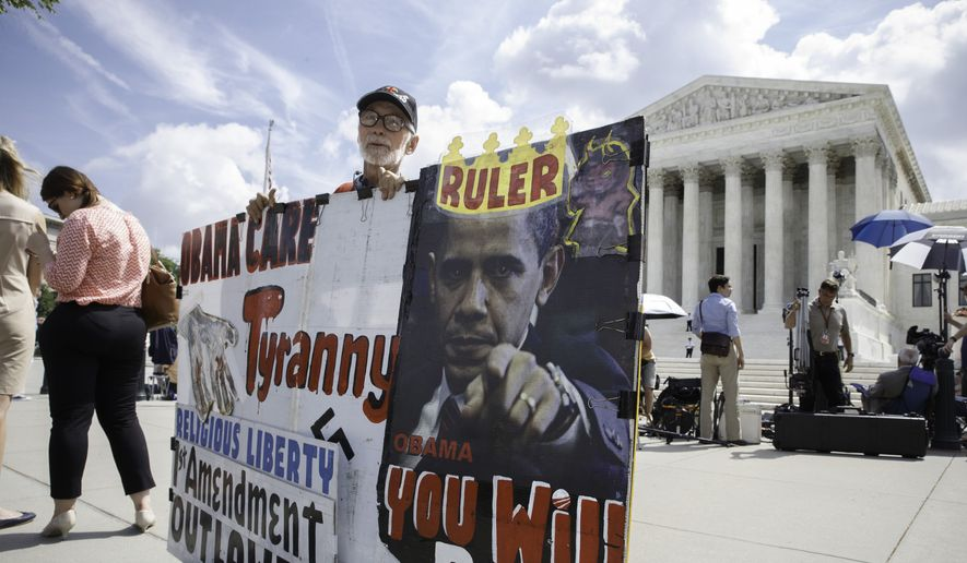 Ronald Brock moves his anti-Obamacare sign as protestors, press and passersby wait for decisions in the final days of the Supreme Court's term, in Washington, Wednesday, June 25, 2014. (AP Photo/J. Scott Applewhite) ** FILE **