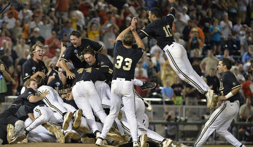 Vanderbilt players, including John Norwood (10), celebrate after defeating Virginia 3-2 in the deciding game of the best-of-three NCAA baseball College World Series finals in Omaha, Neb., Wednesday, June 25, 2014. (AP Photo/Ted Kirk)