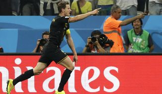 Belgium's Jan Vertonghen celebrates scoring the opening goal during the group H World Cup soccer match between South Korea and Belgium at the Itaquerao Stadium in Sao Paulo, Brazil, Thursday, June 26, 2014. (AP Photo/Lee Jin-man)