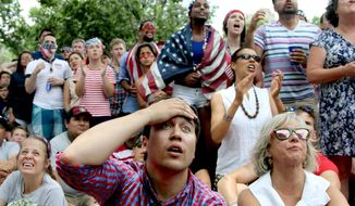 Jack Cooper, 24, center, of Washington, and others, react while watching the US-Germany World Cup soccer match, Thursday, June 26 2014, during a viewing party sponsored by the German Embassy at Dupont Circle in Washington. (AP Photo/Connor Radnovich)
