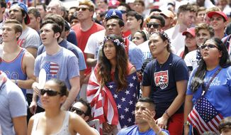 A crowd of soccer fans watches the final minutes of the World Cup Soccer match between the U.S. and Germany during a watch event at Victory Plaza in downtown Dallas, Thursday, June 26, 2014. (AP Photo/LM Otero)