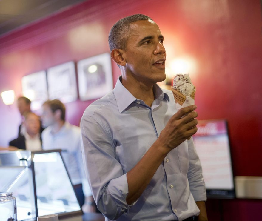 President Barack Obama holds his ice cream cone during a visit to Grand Ole Creamery in St. Paul, Minn., Thursday, June 26, 2014.  (AP Photo/Pablo Martinez Monsivais)