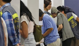 """Since June 20, more than 750,000 Hong Kong residents have voted in a symbolic """"civil referendum"""" in defiance of Beijing to protest eroding freedoms promised by communist-led China when the British handed over the city in 1997. (AP Photo/Kin Cheung)"""