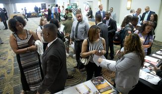 Job seekers and recruiters meet during a job fair in Philadelphia on June 23, 2014. (AP Photo/Matt Rourke)