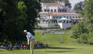 Bill Haas watches his putt on the 11th green during the first round of the Quicken Loans National PGA golf tournament, Thursday, June 26, 2014, in Bethesda, Md. Haas bogeyed the hole. (AP Photo/Patrick Semansky)