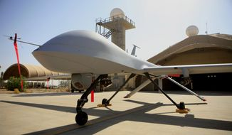 FILE - This June 21, 2007 file photo show a MQ-1 Predator controlled by the 46th Expeditionary Reconnaissance Squadron stands on the tarmac at Balad Air Base, north of Baghdad, Iraq.  A Pentagon official says the U.S. has started flying armed drones over Baghdad to protect U.S. civilians and military forces in the Iraqi capital. The official said the flights started in the last 24 to 48 hours to bolster manned and unmanned reconnaissance flights the military has been sending over violence-wracked Iraq in recent weeks. He spoke on condition of anonymity because he was not authorized to discuss the new flights on the record. (AP Photo/Maya Alleruzzo, File) **FILE**