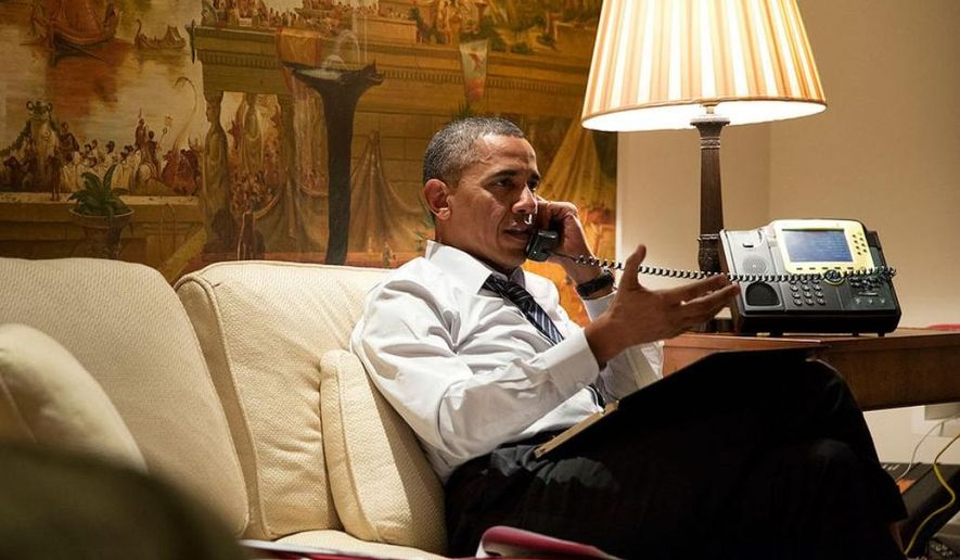 President Barack Obama talks on the phone from his hotel suite in Seoul, Republic of Korea, April 25, 2014. (Official White House Photo by Pete Souza)