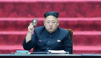 In this Wednesday, April 9, 2014, image made from video, North Korean leader Kim Jong-un holds up a parliament membership certificate during the Supreme People's Assembly in Pyongyang, North Korea. (AP Photo/KRT via AP Video, File) ** FILE **