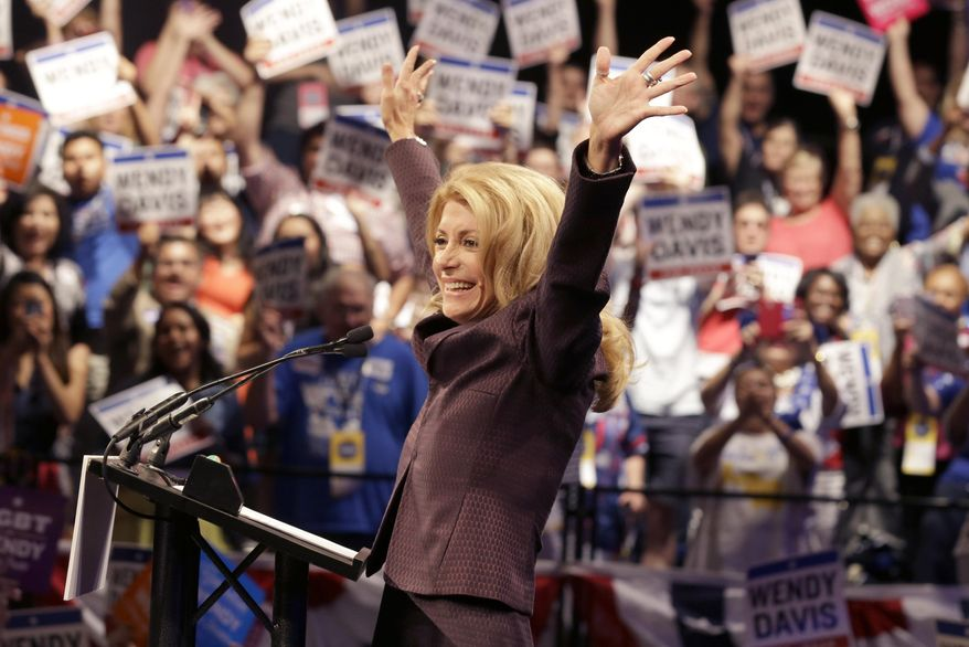 Gubernatorial hopeful and state Sen. Wendy Davis waves before speaking at the Dallas Convention Center during the Texas Democratic Convention in Dallas, Friday, June 27, 2014. (AP Photo/LM Otero)