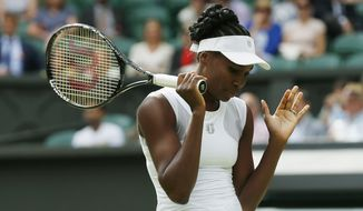 Venus Williams of U.S. gestures during her women's singles match against Petra Kvitova of the Czech Republic at the All England Lawn Tennis Championships in Wimbledon, London, Friday, June 27, 2014. (AP Photo/Sang Tan)
