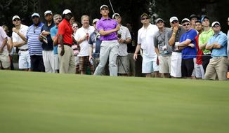 Oliver Goss, of Australia, watches his shot from the 18th fairway during the second round of the Quicken Loans National PGA golf tournament, Friday, June 27, 2014, in Bethesda, Md. (AP Photo/Patrick Semansky)