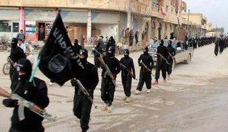This undated file image posted on a militant website on Tuesday, Jan. 14, 2014, which has been verified and is consistent with other AP reporting, shows fighters from the al Qaeda-linked Islamic State of Iraq and the Levant (ISIL) marching in Raqqa, Syria. (AP Photo/Militant Website, File)