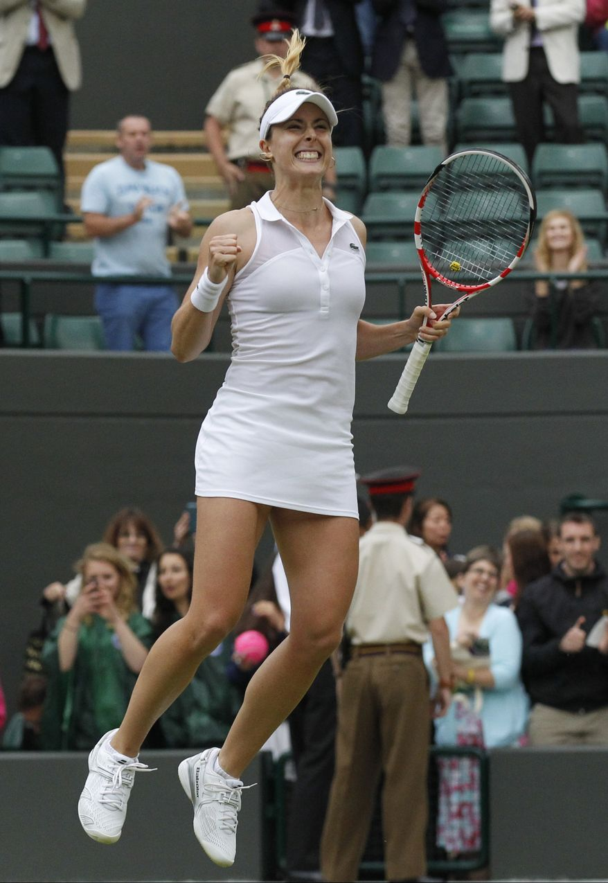 Alize Cornet of France celebrates defeating Serena Williams of U.S. in the women's singles match at the All England Lawn Tennis Championships in Wimbledon, London, Saturday, June 28, 2014. (AP Photo/Sang Tan)