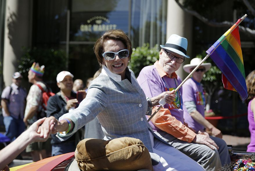 House Minority Leader Nancy Pelosi shakes hands while riding in the 44th annual San Francisco Gay Pride parade Sunday, June 29, 2014, in San Francisco. The lesbian, gay, bisexual, and transgender celebration and parade is one of the largest LGBT gatherings in the nation. (AP Photo/Eric Risberg)