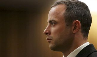 FILE - In this Tuesday, May 20, file photo, Oscar Pistorius listens as a court ruling is handed down that he would undergo psychiatric evaluation in Pretoria, South Africa. The murder trial of Pistorius resumes Monday, June 30, 2014 after one month during which mental health experts evaluated the athlete to determine if he has an anxiety disorder that could have influenced his actions on the night he killed girlfriend Reeva Steenkamp. (AP Photo/Siphiwe Sibeko, Pool, File)