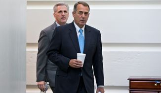Speaker of the House John A. Boehner, right, and House Majority Leader-elect Kevin McCarthy are lukewarm on the issue of reauthorizing the Export-Import Bank despite supporting previous renewals of the bank's charter. Backers of reauthorization claim that doing so will lead to job creation and an expanded economy, while opponents say the charter should be allowed to expire. (associateD press)