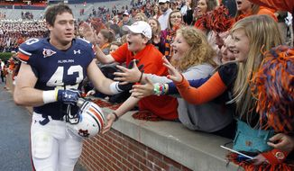 Auburn tight end Philip Lutzenkirchen (43) celebrates with fans after their win 35-16 over Samford in an NCAA college football game on Saturday, Nov. 19, 2011, in Auburn, Ala.  (AP Photo/Butch Dill)