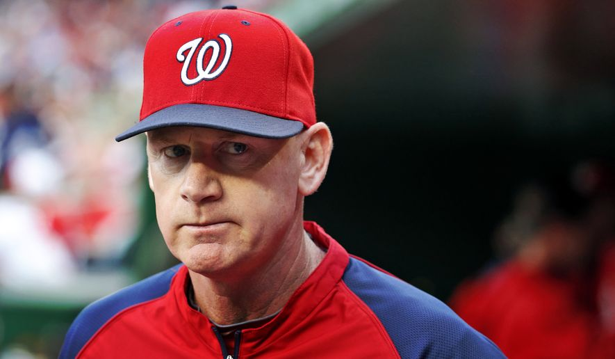Washington Nationals manager Matt Williams (9) walks in the dugout before a baseball game against the Atlanta Braves at Nationals Park Saturday, June 21, 2014, in Washington. (AP Photo/Alex Brandon)