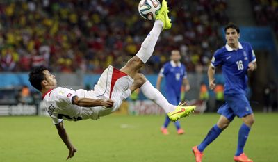 Costa Rica's Giancarlo Gonzalez kicks the ball during the World Cup round of 16 soccer match between Costa Rica and Greece at the Arena Pernambuco in Recife, Brazil, Sunday, June 29, 2014. (AP Photo/Andrew Medichini)