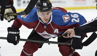 FILE - In this Jan. 2, 2014 file photo, Colorado Avalanche center Paul Stastny (26) looks on before a face off against the Philadelphia Flyers during the first period of an NHL hockey game in Denver. NHL teams can begin making deals with free agents Tuesday, July 1, 2014. (AP Photo/Jack Dempsey, File)